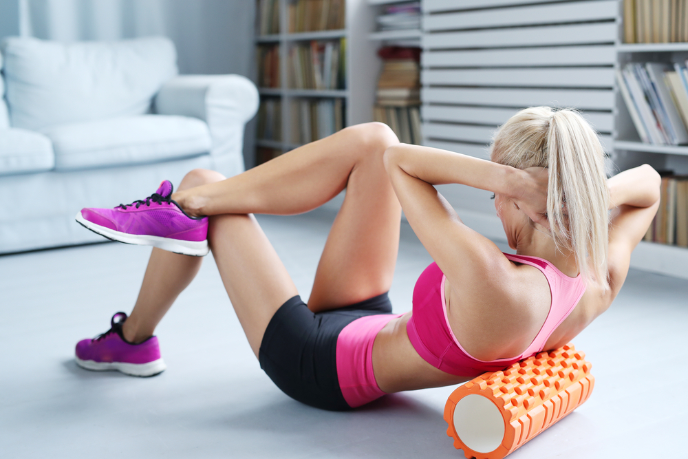 woman working out with a foam roller
