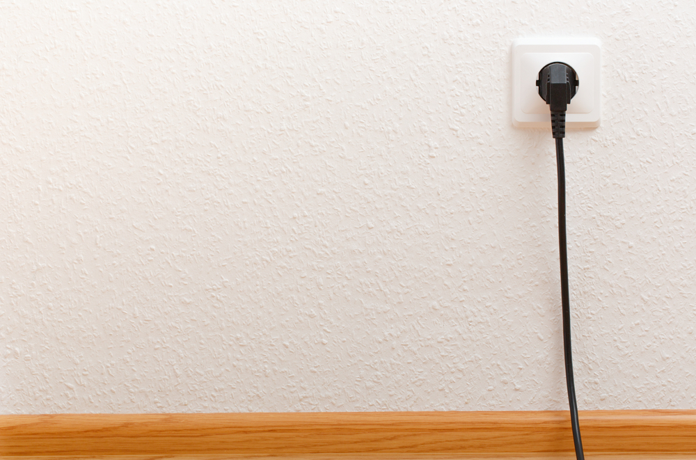 black cord plugged into wall