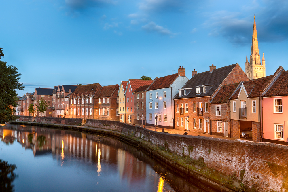 historic town houses at night on quay side in norwich, norfolk