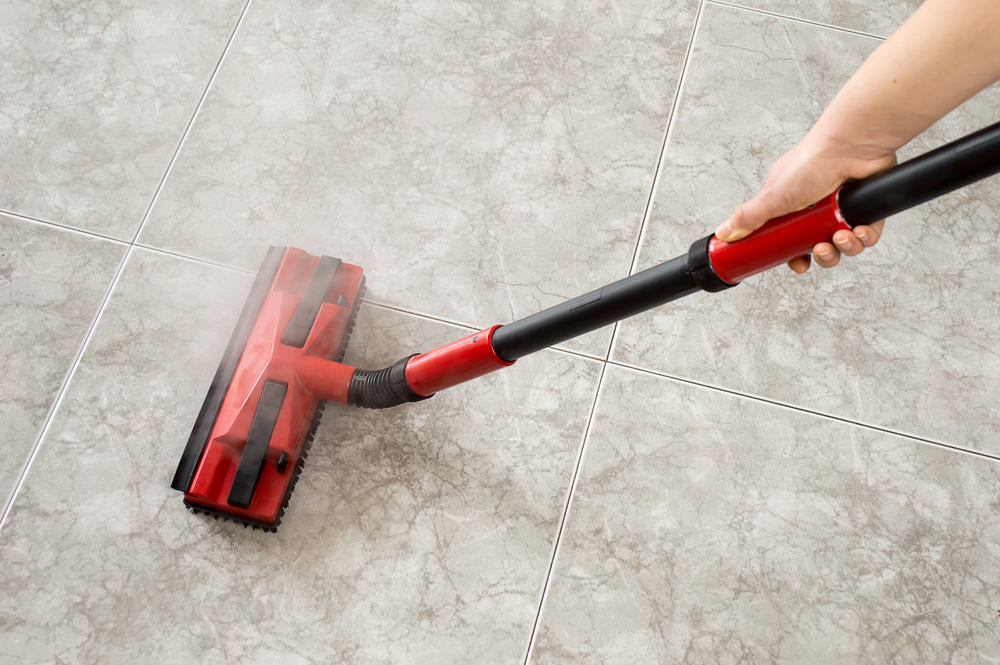 steam cleaning with red mop