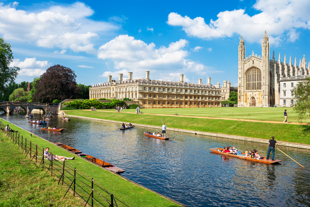 tourists on punt trip (sightseeing with boat) along river cam near kings college in the city of cambridge