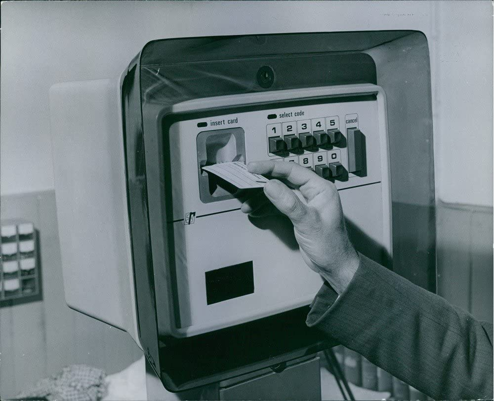 This machine lets us take out cash without having to go to the bank. What is it?