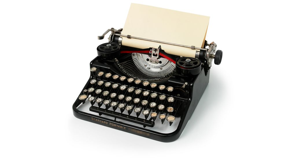 Before computers, which machine was used for writing?