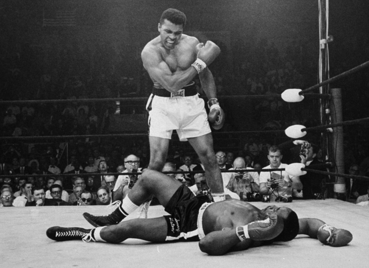 Who won a boxing match against George Foreman?