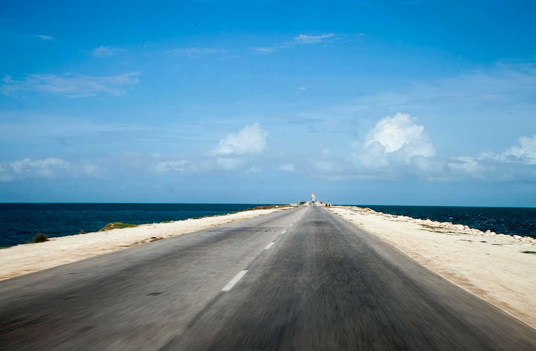 What country is the road located that actually disappears and comes back during the day?