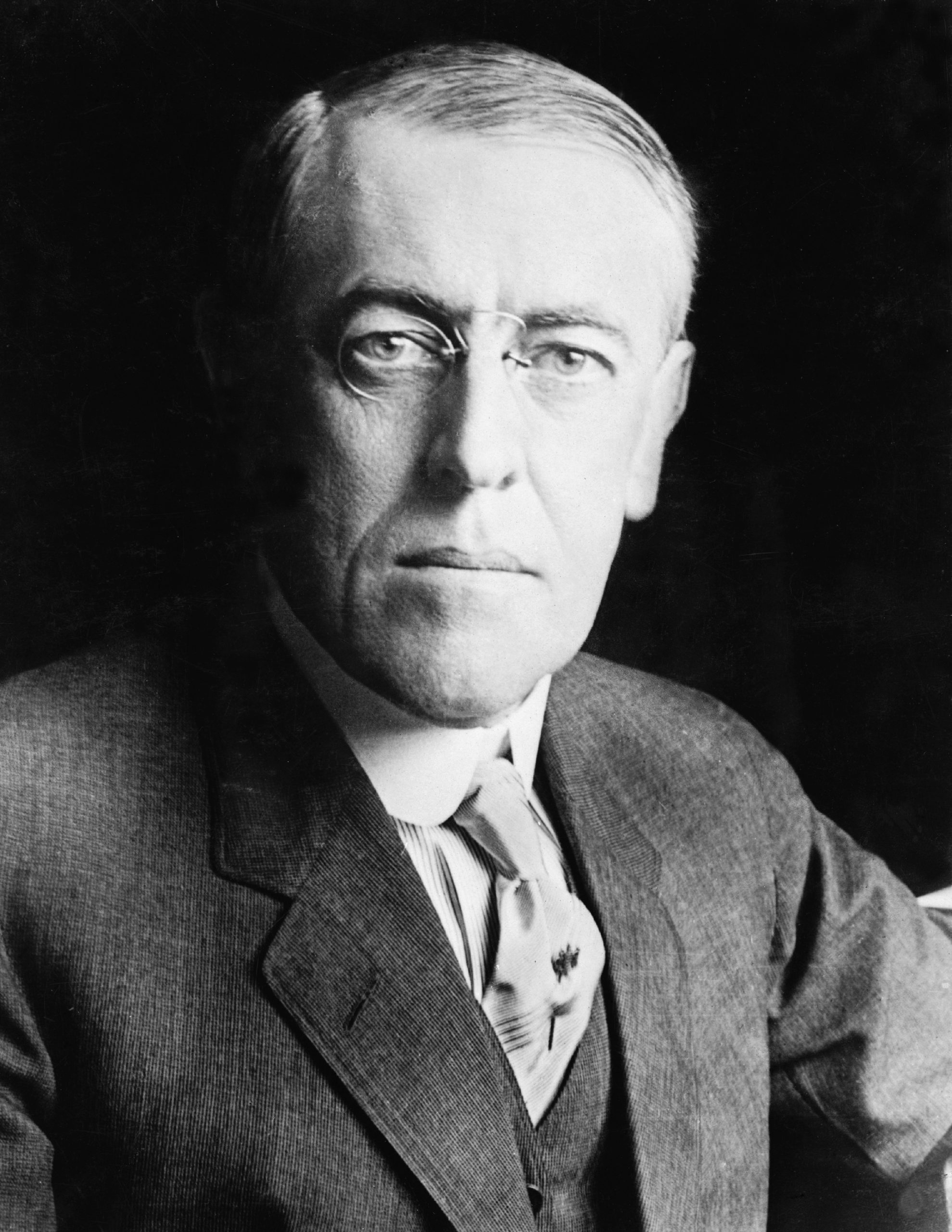 """He, a leader of the Progressive Movement, was the 28th President of the United States (1913-1921). After a policy of neutrality at the outbreak of World War I, he led America into war in order to """"make the world safe for democracy."""""""