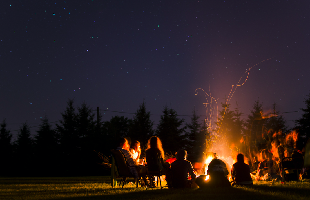 Who reminds campers in the summer to practice campfire safety?